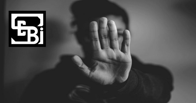 Image of a person holding out her hand to say 'stop'. This is representative of the reaction to SEBI's consulation paper changes to investment advisor regulations