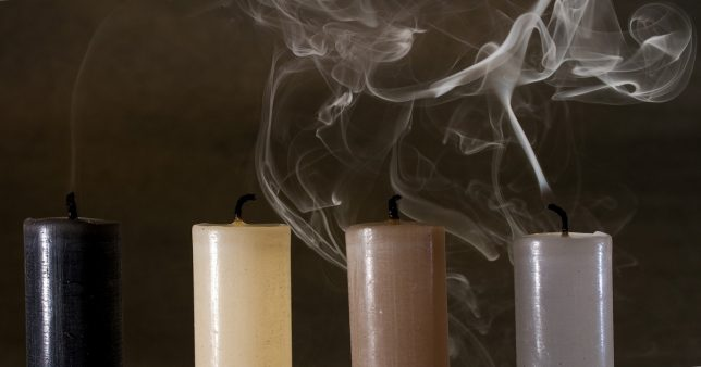 Image of candles smoking reperesenting the state of the Indian market valuation today