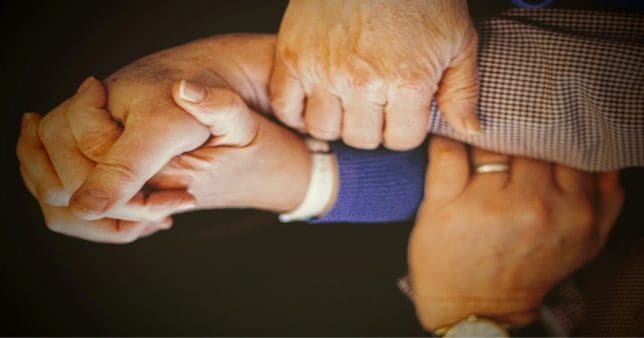 Image of a family holding hands representing a Hindu Undivided Family (HUF) that can avail special tax benefits